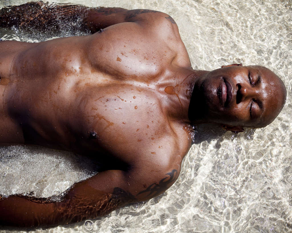 Steve Bontemps model in Mauritius lying in the sea on the beach