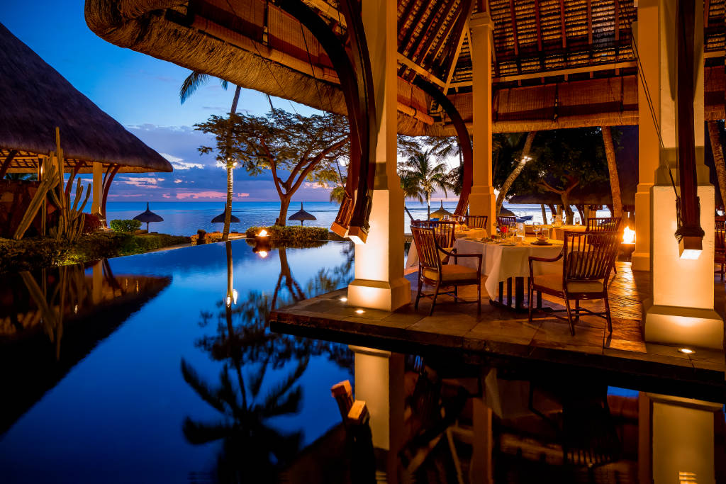 The Oberoi Mauritius Main Restaurant in the evening with pool surround